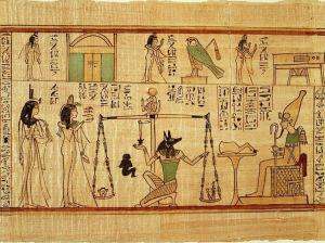 «محاكمة الموتى» حيث يجلس أوزيريس على عرشه يحاسب البشر، بينما يقوم أنوبس بوزن قلب الميت للحكم على أعماله.